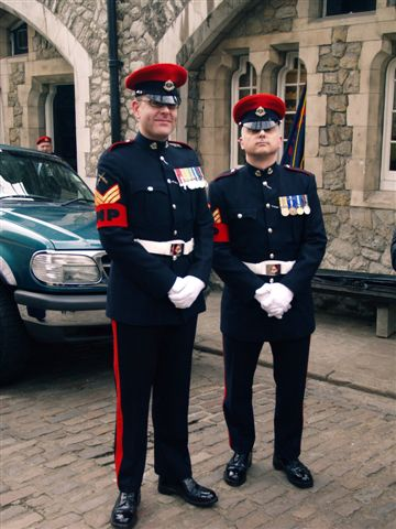 A picture of two active Military Policemen in Parade Dress